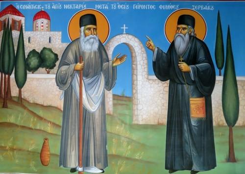 Η συνάντησις του Αγίου Νεκταρίου μετά του Οσίου γέροντος Φιλόθεου Ζερβάκου. ( Διαστ. 1.90 Χ 1.50, σκόνες αγιογ. σε πανί ).